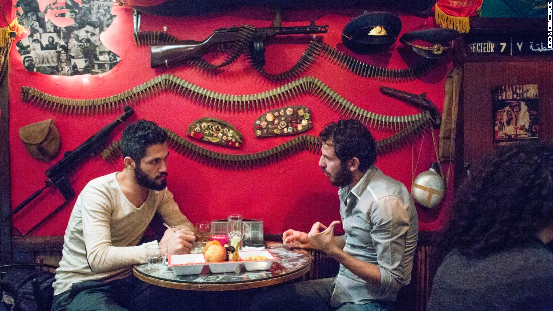 Two men have a conversation at Abu Elie, a bar in Beirut, Lebanon.