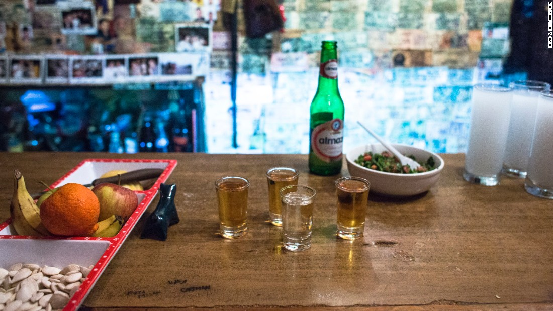 Shots await CNN's Anthony Bourdain and Ernesto, the son of the owner of Abu Elie bar. Seen on the bar, a bottle of Almaza beer. The brand was founded in 1933 and, until 2006, was practically the only beer brewed in Lebanon.