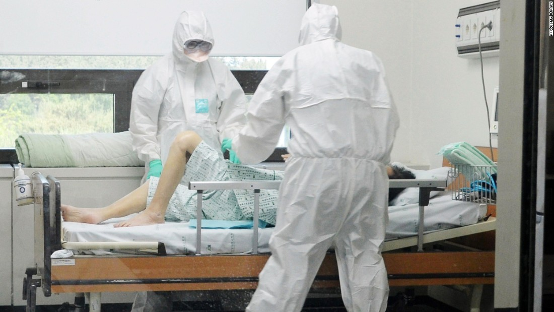 This picture taken on June 7, 2015 shows medical workers caring for a MERS patient at Konyang University Hospital in Daejeon, south of Seoul, South Korea.