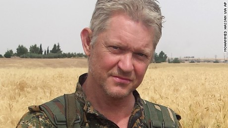 Michael Enright, a British actor who has had minor roles in Hollywood films, poses for a photo after he joined Kurdish fighters battling against ISIS.