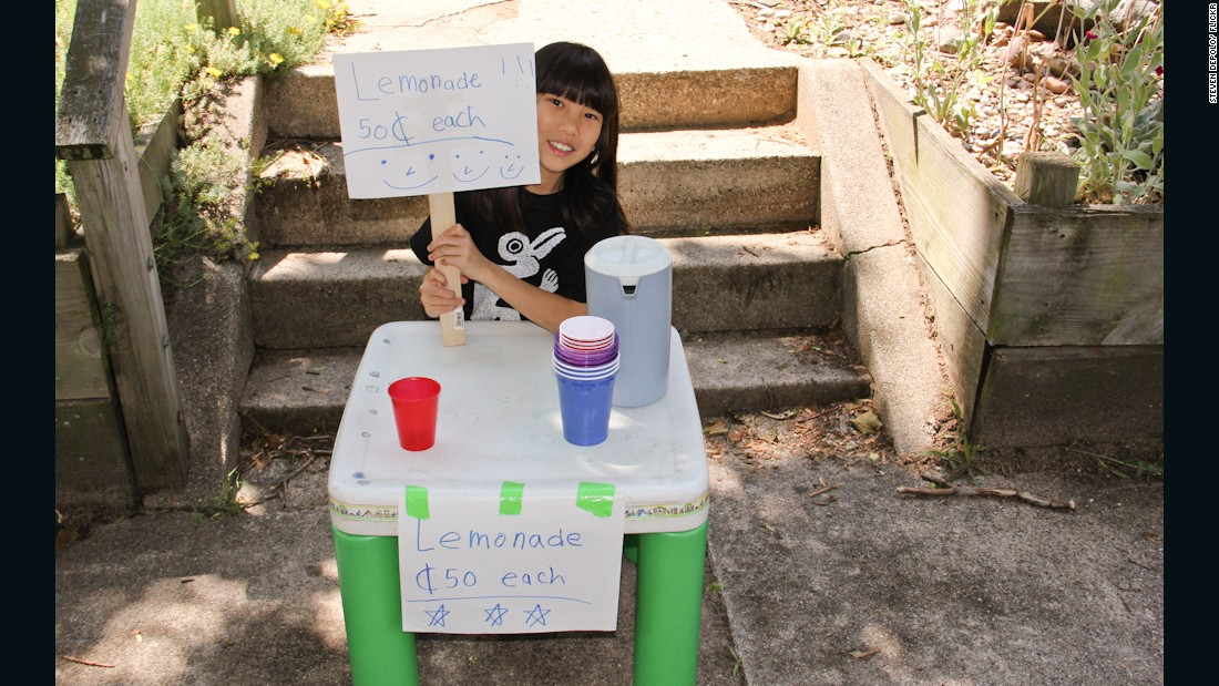 A young girl sells lemonade for 50 cents each in June 2011.