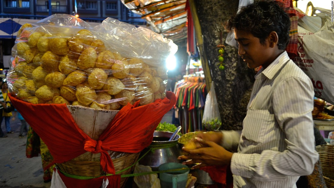 A puchka vendor makes a small hole in the fried dough ball, which will then be stuffed with filling and dunked into a tamarind and green mango sauce. Chef Gaggan Anand of Bangkok restaurant Gaggan says Kolkata street food like this transports him back to his childhood.