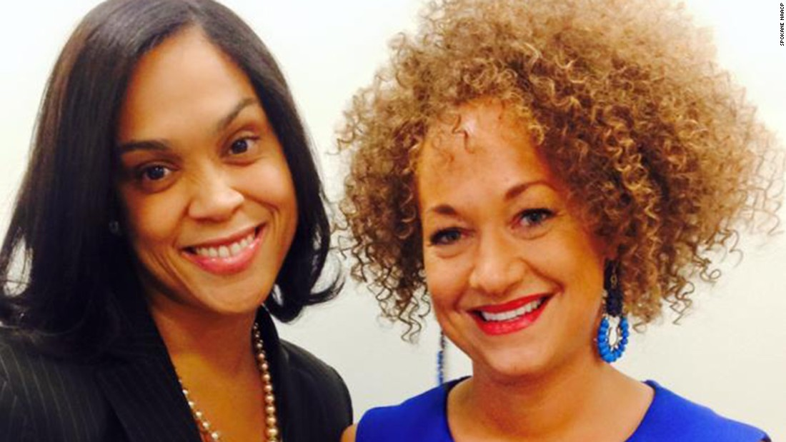 "Dolezal poses for a picture with prosecutor Marilyn Mosby. Dolezal's mother said on Friday, June 12, that her daughter ""has not explained to us why she is doing what she's doing and being dishonest and deceptive with her identity."""