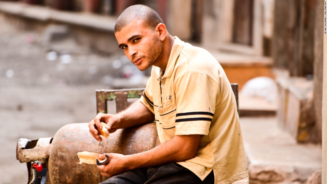 "<strong>The entrepeneurs: </strong>PR<strong> </strong>consultant <a href=""http://ireport.cnn.com/docs/DOC-1248147"">Zeyad Mourad </a>saw this young man selling gas cylinders in Cairo - a common sight in a city where fuel can be scarce. ""What adds a special touch is the young man's posture and his not shying back from the camera, almost giving a defiant yet accepting look,"" he says."