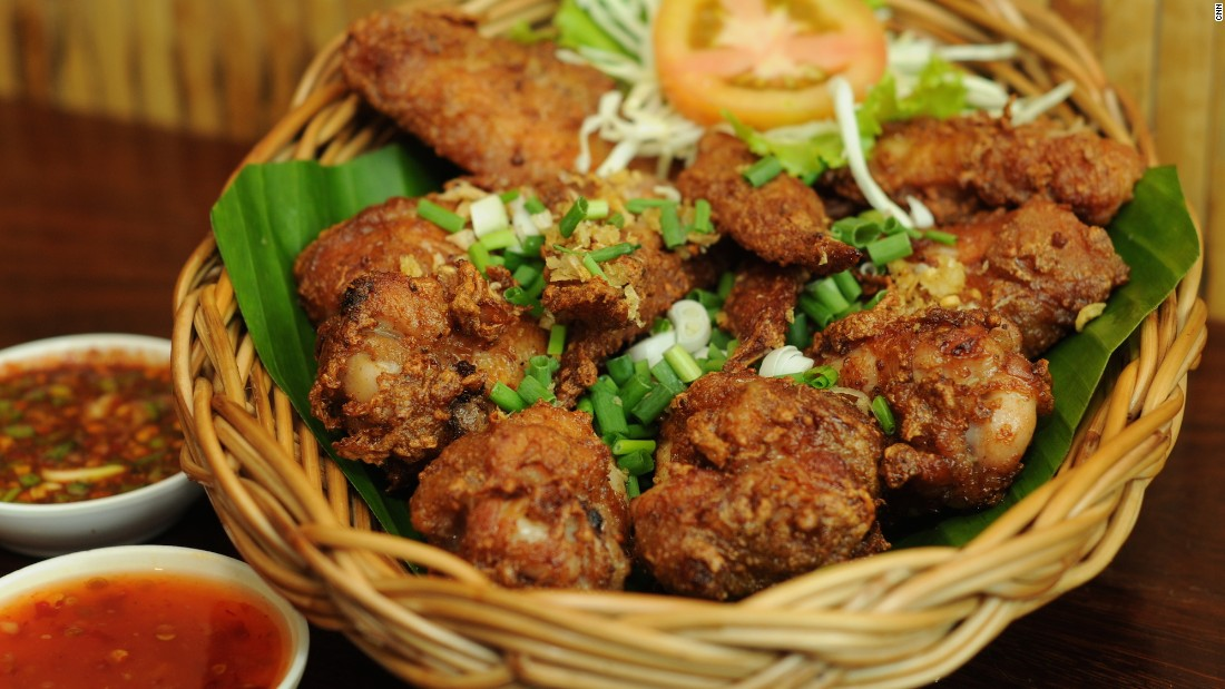 "You'll never hit up a KFC again once you've tasted gai tod, which indeed translates directly to ""fried chicken"". It can be found at many of Bangkok's Isaan restaurants and is usually accompanied with one of two dipping sauces -- spicy nam jim jaew or sweet chilli sauce. Sometimes you get both."