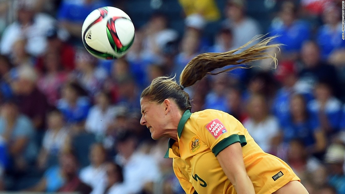 Australia defender Laura Alleway heads the ball.