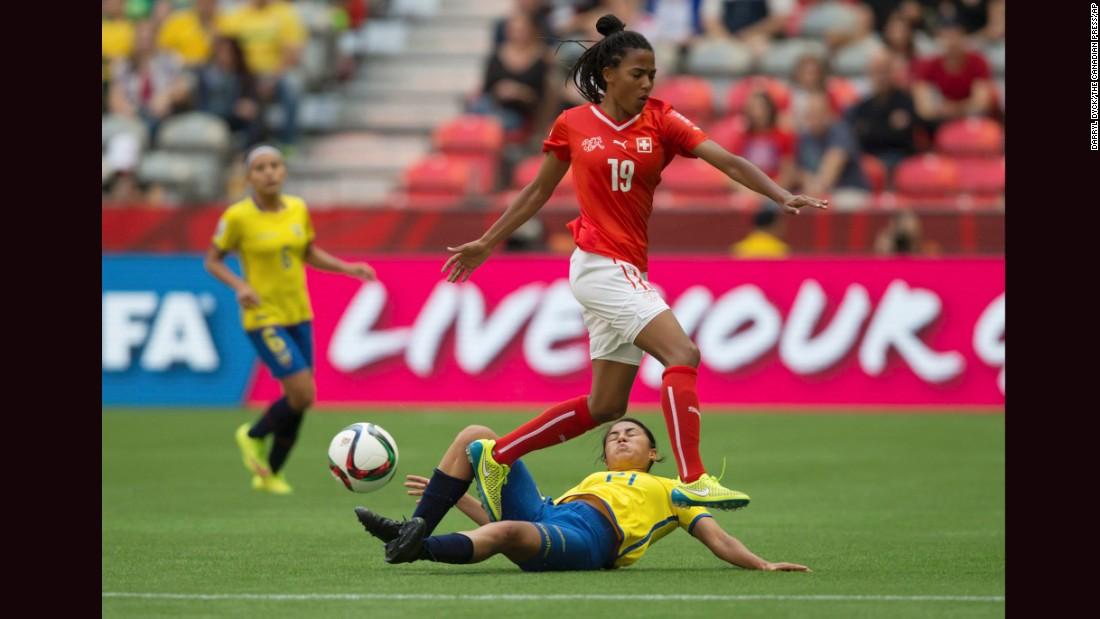 Ecuador's Mabel Velarde slides to take the ball away from Aigbogun.