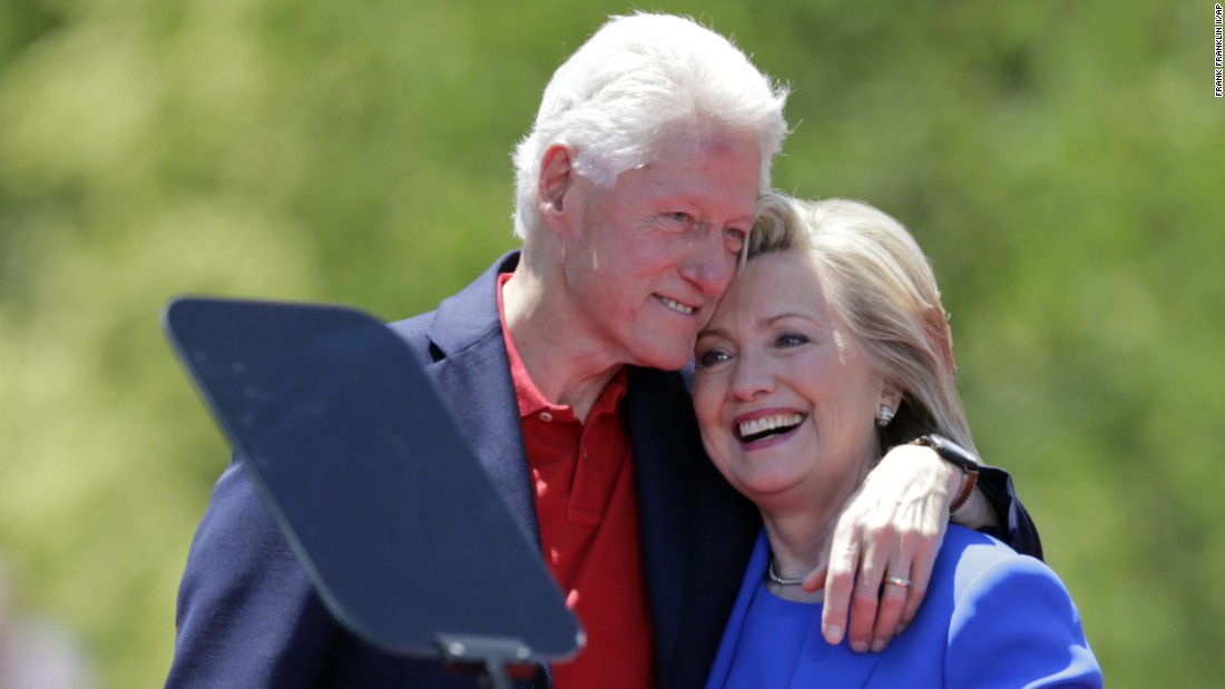 Hillary Clinton gets a hug from the former president.