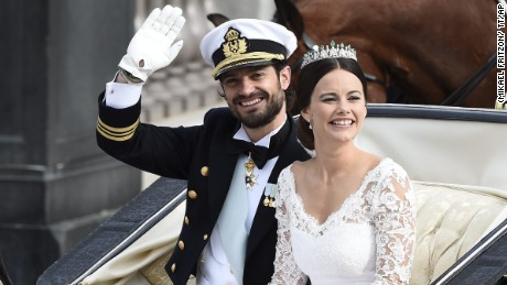 Sweden's Prince Carl Philip sits with his bride, Sofia Hellqvist in a carriage, after their wedding ceremony,  in Stockholm, Sweden, on Saturday, June 13.   Prince Carl Philip and the former reality starlet and model Sofia Hellqvist, 30, tied the knot Saturday at the Royal Palace chapel before five European queens, a Japanese princess and dozens of other blue-blooded guests.
