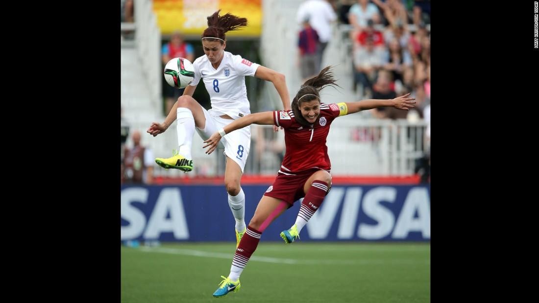 England midfielder Jill Scott, left, and Mexico midfielder Nayeli Rangel battle for the ball.