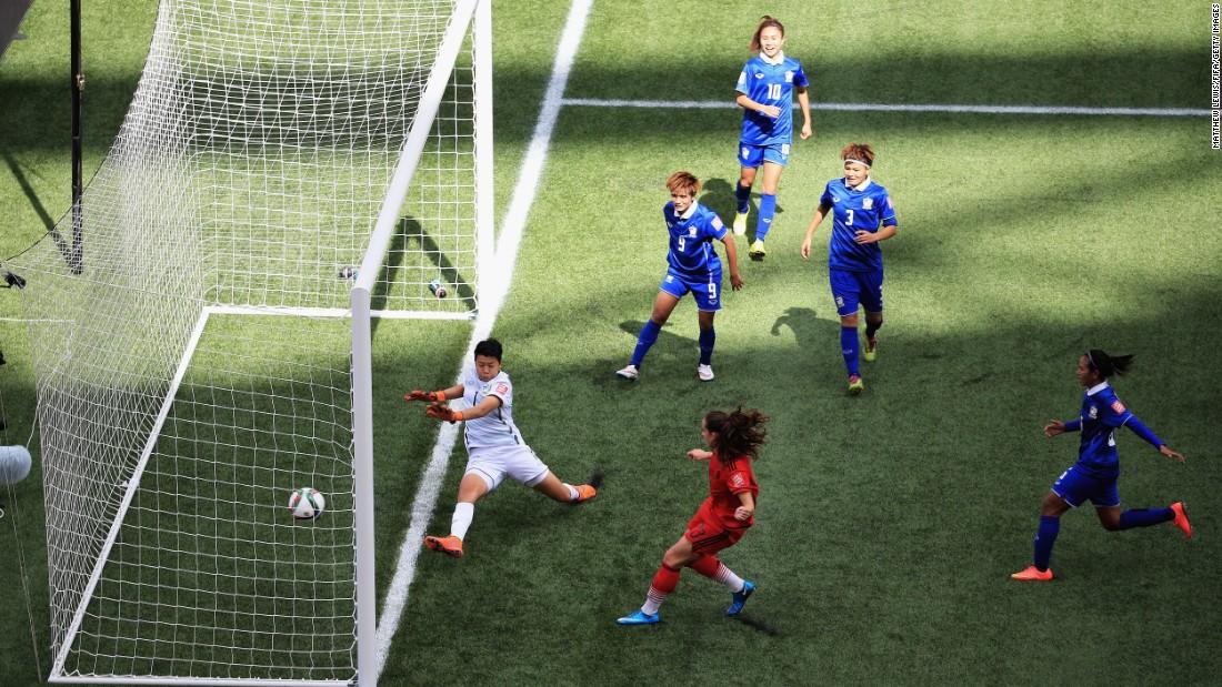 Sara Daebritz scores a goal for Germany.