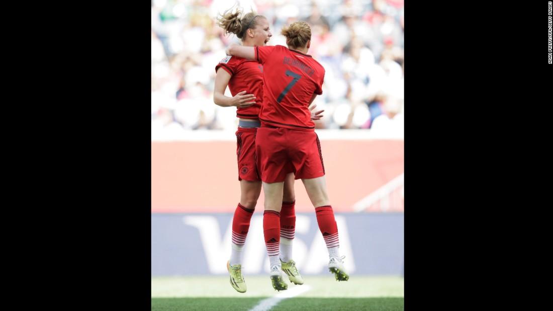 Lena Petermann celebrates with German teammate Melanie Behringer.