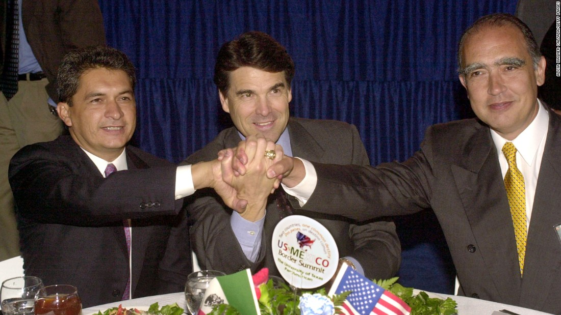 Mexican politician Tomas Yarrington, from left, then-Texas Gov. Rick Perry and Nuevo Leon Gov. Fernando Canales Clariond join hands during the U.S. and Mexico Border Summit on August, 22, 2001, in Edinburg, Texas. Perry, who is currently running for the 2016 GOP presidential nomination, is headed to the Rio Grande Valley in June for a fund-raiser with area elected officials.