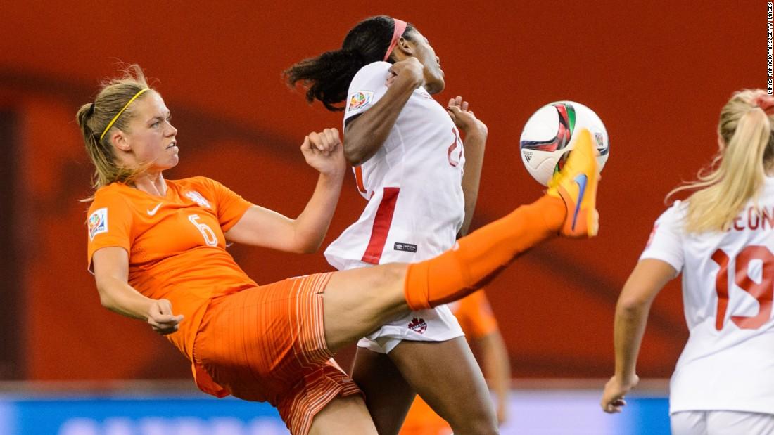 Dekker kicks the ball in front of Lawrence.