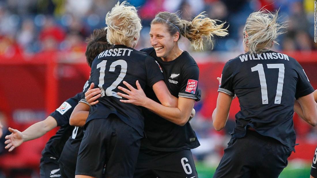 New Zealand's Rebekah Stott, center, and Betsy Hassett celebrate Stott's goal.