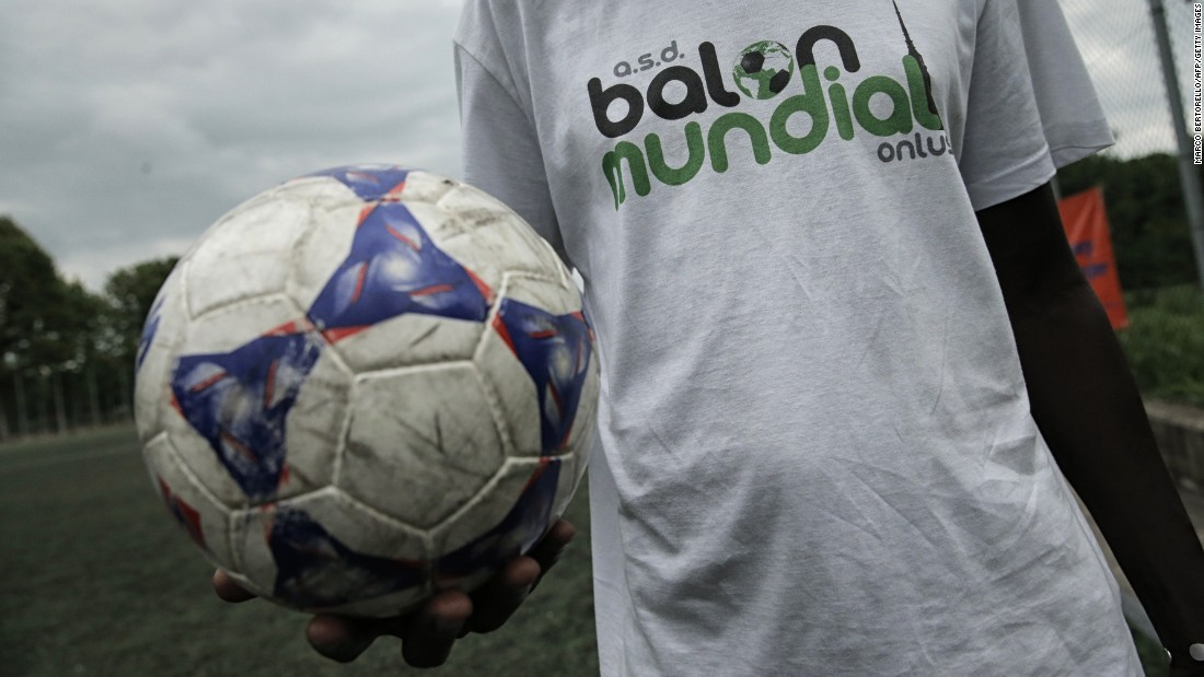 A number football initiatives have been set up to help bridge the gap between migrant and existing communities in Europe in recent years.  Here, a player poses with a ball at the Balon Mundial 2015 tournament for migrant footballers and foreigners in the city of Turin, Italy.
