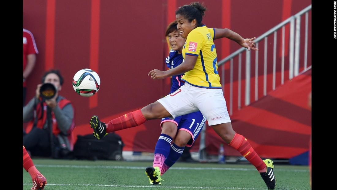 Japan forward Shinobu Ohno and Ecuador forward Denise Pesantes compete for the ball.