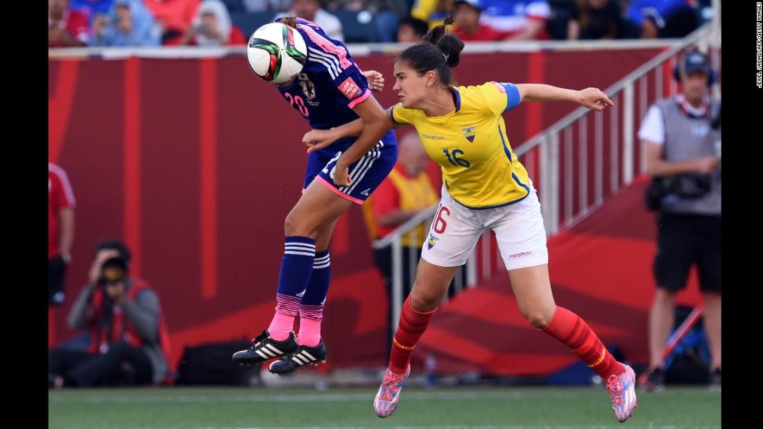 Japan defender Yuri Kawamura, left, and Ecuador defender Ligia Moreira go for the ball.