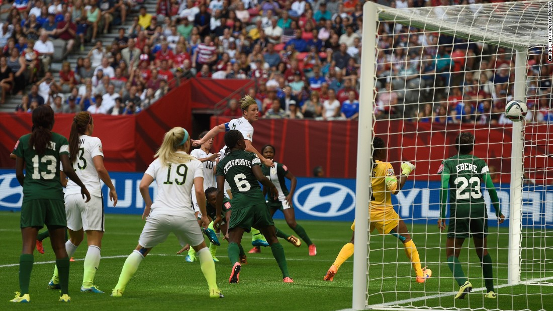 Wambach, top, scores against Nigeria during a match Tuesday, June 16, in Vancouver, British Columbia. The Americans won the match 1-0, clinching top spot in their group.