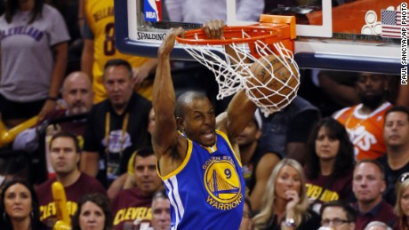 Golden State Warriors guard Andre Iguodala (9) dunks against Cleveland Cavaliers forward James Jones (1) during the second half of Game 6 of basketball's NBA Finals in Cleveland, Tuesday, June 16, 2015.
