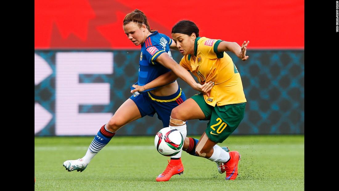 Sweden's Jessica Samuelsson, left, takes on Samantha Kerr of Australia.