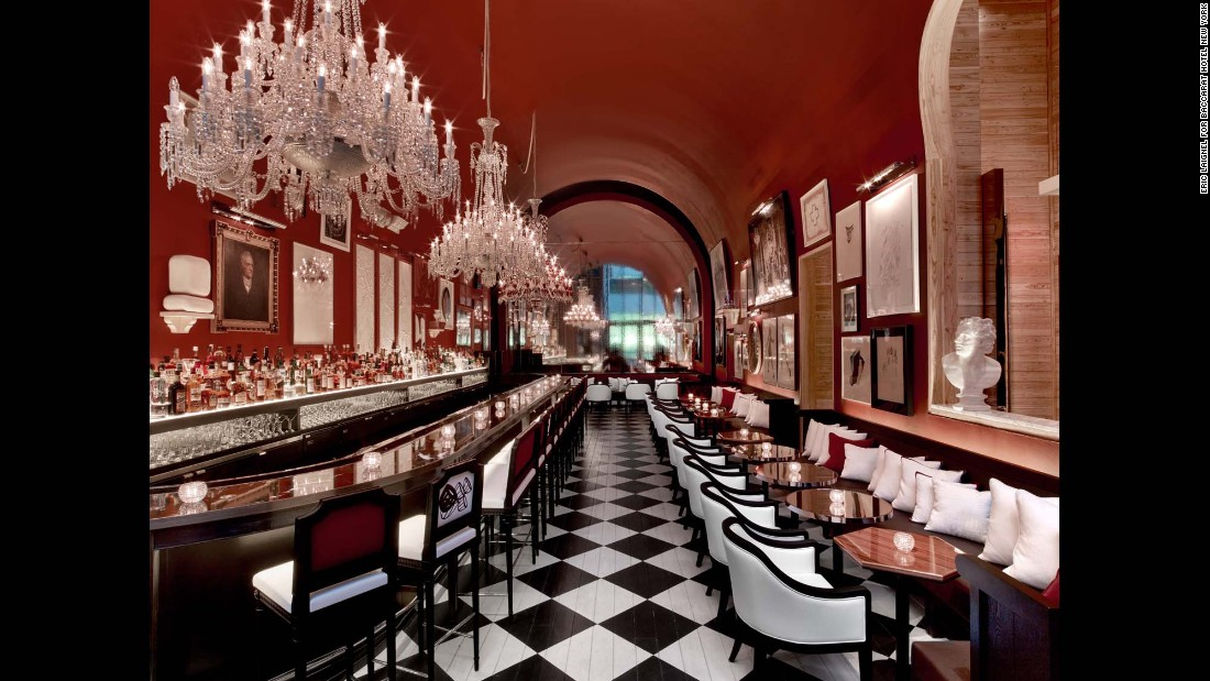 The Bar at Baccarat displays a range of works salon-style on its rich red walls.