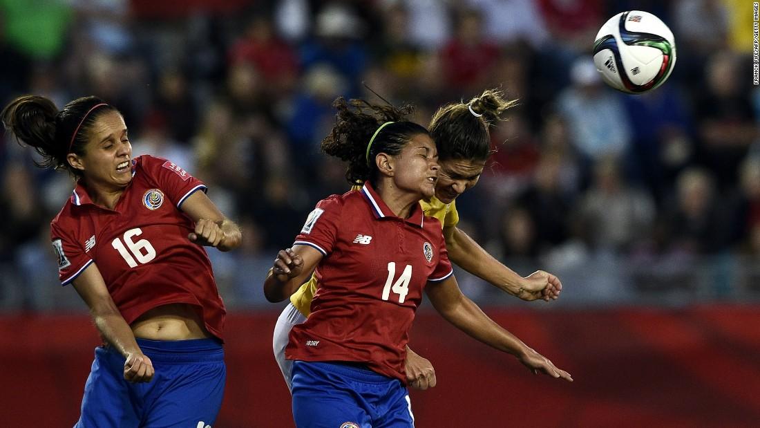 Costa Rican midfielder Katherine Alvarado, left, and forward Maria Barrantes jump for the ball.
