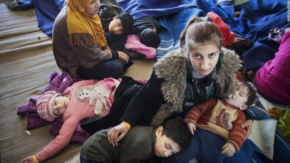 A Syrian refugee mother comforts her children, after being rescued from a fishing boat carrying 219 people who had hoped to reach Europe. They are among the millions uprooted by war.