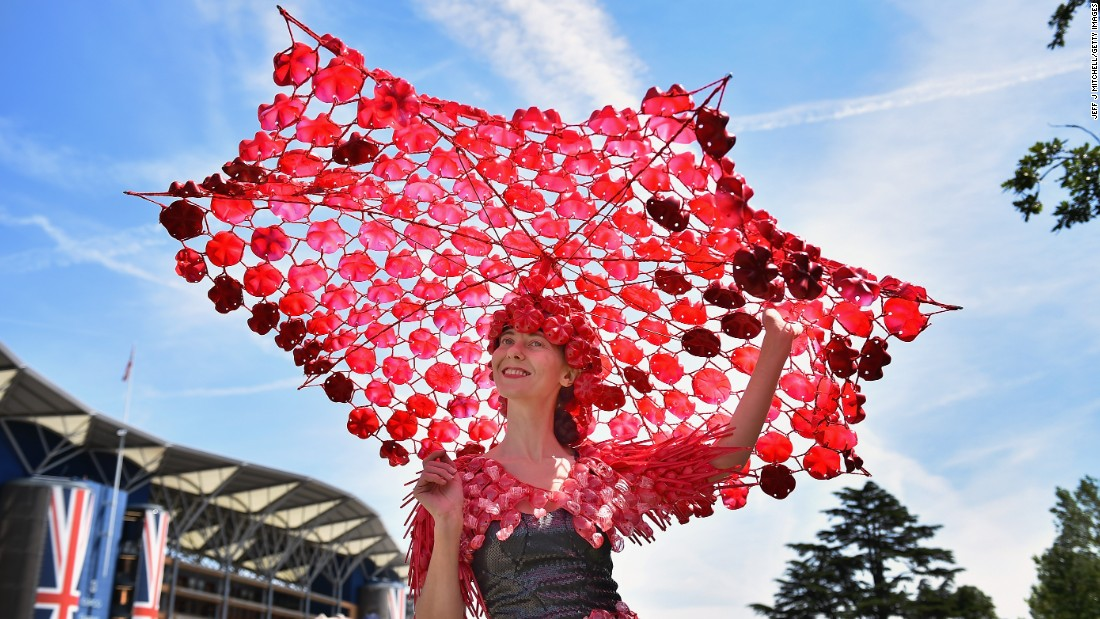 """The ladies go to a hell of a lot of effort on Ladies' Day,"" says horse racing journalist Oliver Brett, who attempted to seek shade under this fantastically large creation."