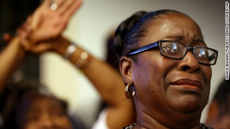 Rev. Jeannie Smalls cries during a prayer vigil held at Morris Brown AME Church for the victims of Wednesday's shooting at Emanuel AME Church on Thursday, June 18, 2015 in Charleston, S.C.  Dylann Storm Roof, 21, was arrested Thursday in the slayings of several people, including the pastor at a prayer meeting inside the historic black church.(Grace Beahm/The Post And Courier via AP, Pool)
