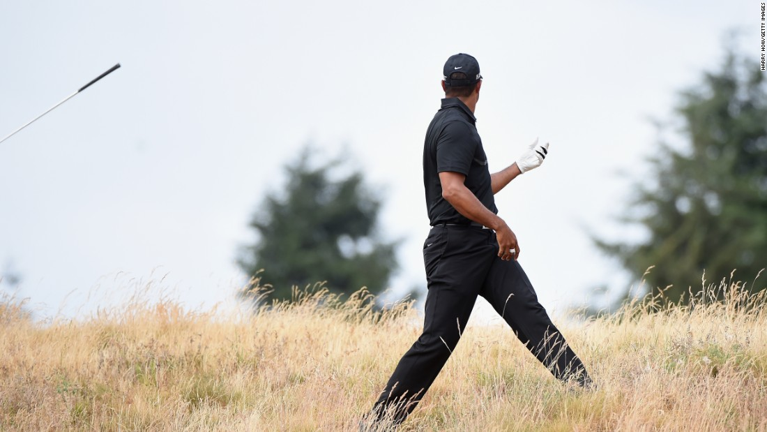 Woods throws his club in disgust following a shot from the rough during the first round of the 2015 U.S. Open at Chambers Bay in June, when he missed the halfway cut after rounds of 80 and 76.