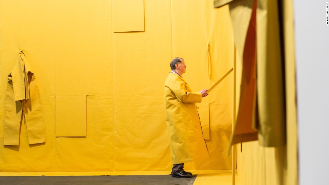 Performance artist Franz Erhard Walther's 'Wallformation Gelbmodellierung' at Unlimited Basel.