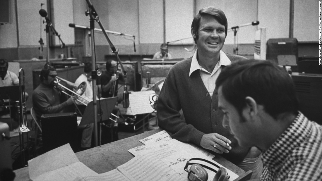 "In the early 1960s, Campbell signed with Capitol Records. Here, he is seen at a recording session with producer Al DeLory, who helped Campbell achieve a number of hit singles and albums including ""Gentle on My Mind"" and ""By the Time I Get to Phoenix."""