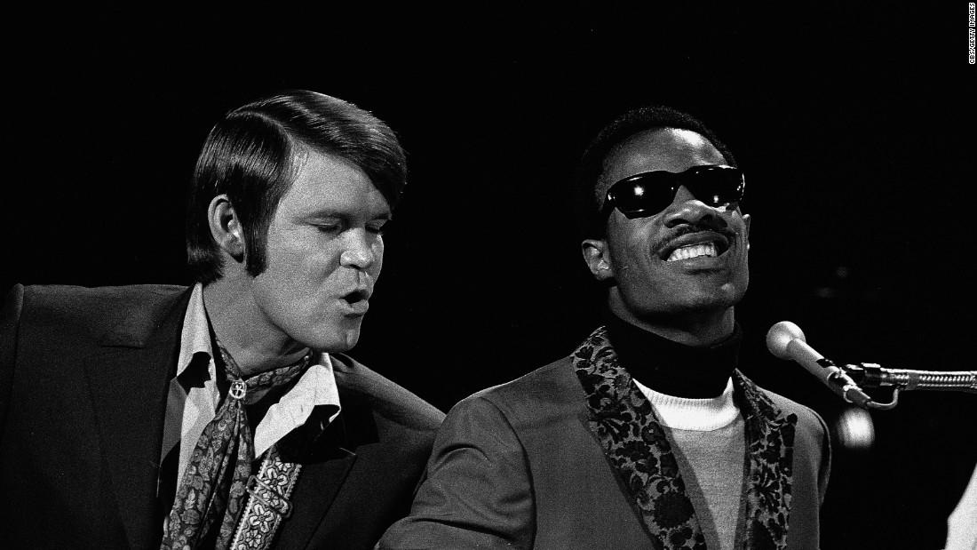 "Campbell's appearances on ""The Smothers Brothers Comedy Hour"" led to his own own variety series, ""The Glen Campbell Goodtime Hour."" Here, Campbell performs with Stevie Wonder on the show."