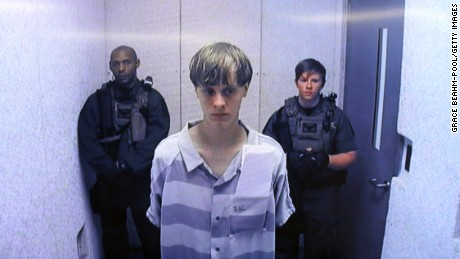 NORTH CHARLESTON, SC - JUNE 19:  In this image from the video uplink from the detention center to the courtroom, Dylann Roof appears at Centralized Bond Hearing Court June 19, 2015 in North Charleston, South Carolina. Roof is charged with nine counts of murder and firearms charges in the shooting deaths at Emanuel African Methodist Episcopal Church in Charleston, South Carolina on June 17. (Photo by Grace Beahm-Pool/Getty Images)