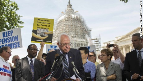 U.S. Senate Budget Committee ranking member Senator Bernie Sanders, center, I-Vermont, speaks during a news conference to discuss legislation to restore pension guarantees for thousands of retired union workers, in front of the US Capitol in Washington, D.C., June 18, 2015.
