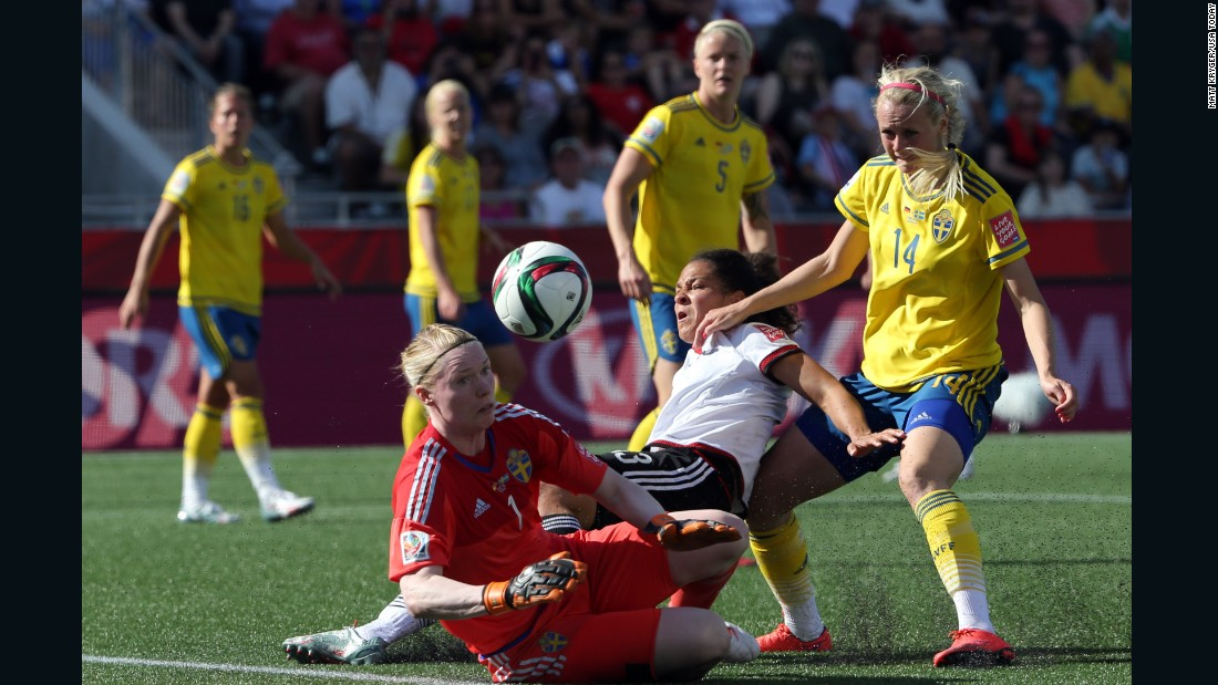 German forward Celia Sasic collides into Swedish goalkeeper Hedvig Lindahl.