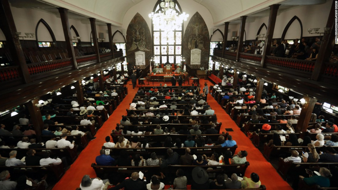 Parishioners fill the pews for the service. Church elders decided to hold the regularly scheduled Sunday school and worship service as they continue to grieve.