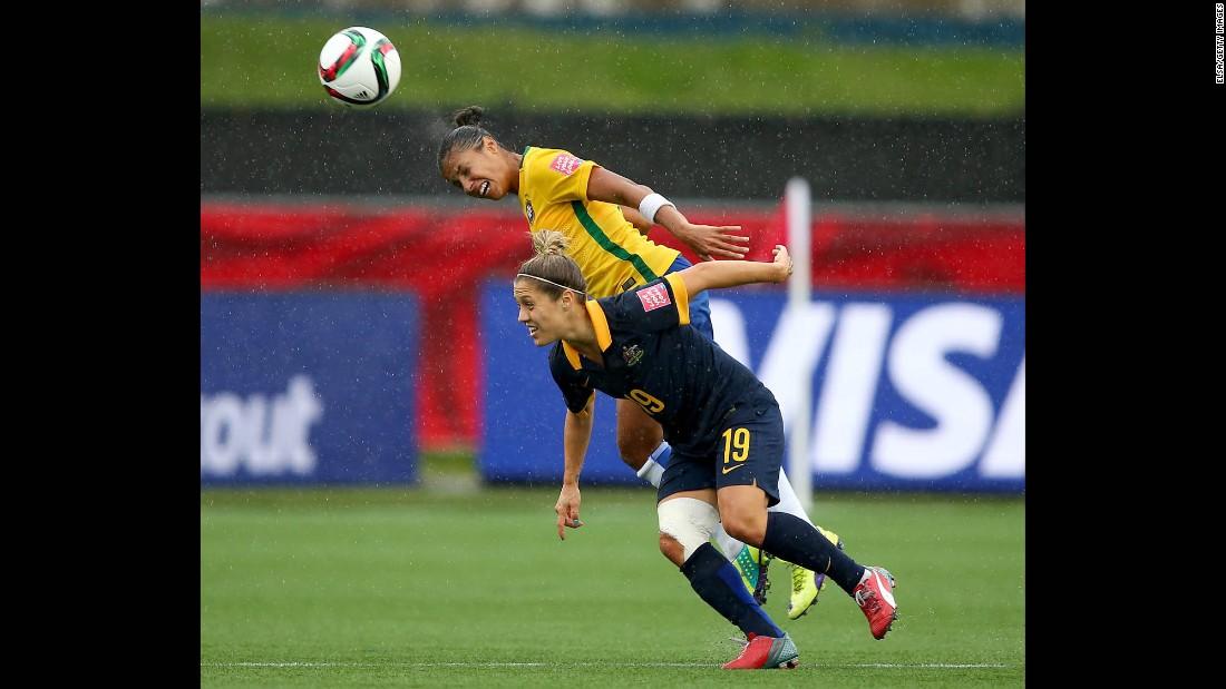 Fabiana heads the ball above Australia's Katrina Gorry.