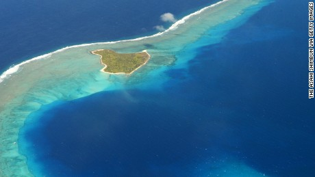 BIKINI ATOLL, MARSHALL ISLANDS - JANUARY 27:  (CHINA OUT, SOUTH KOREA OUT) In this aerial image, 80-meter-deep Bravo Crater is seen on January 27, 2014 in Bikini Atoll, Marchall Islands. The crater was created on March 1, 1954, when a 15-megaton bomb was detonated as part of the U.S. Castle Bravo project. The bomb was 1,000 times more powerful than the atomic bomb dropped on Hiroshima. The United States conducted 67 tests of nuclear weapons in the Marshall Islands, the site of the U.S. Pacific Proving Grounds, between 1946 and 1958. In 1977, radioactive strontium-90 exceeding U.S. environmental standards was detected in well water. The following year, the U.S. Interior Department said cesium-137 levels on the atoll were so high that residents could not permanently live there. That forced the islanders to once again leave the atoll. With the 60th anniversary of the hydrogen bomb test approaching, there is still no indication of when the former residents can return.  (Photo by The Asahi Shimbun via Getty Images)