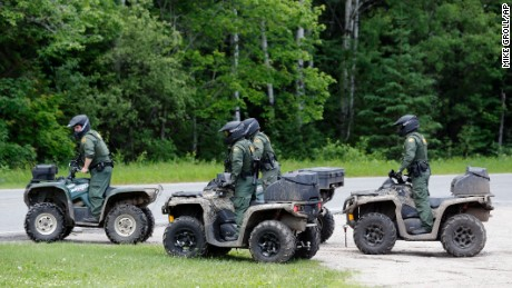 Law enforcement officers on all terrain vehicles pull out of the parking lot of a restaurant as the search for two escaped prisoners from Clinton Correctional Facility in Dannemora continues, on Monday, June 22, 2015, in Mountain View, N.Y. manhunt for two convicted murderers has jumped from a railroad line near the Pennsylvania state line to a hamlet in far northern New York not far from the prison they escaped from more than two weeks ago. (AP Photo/Mike Groll)