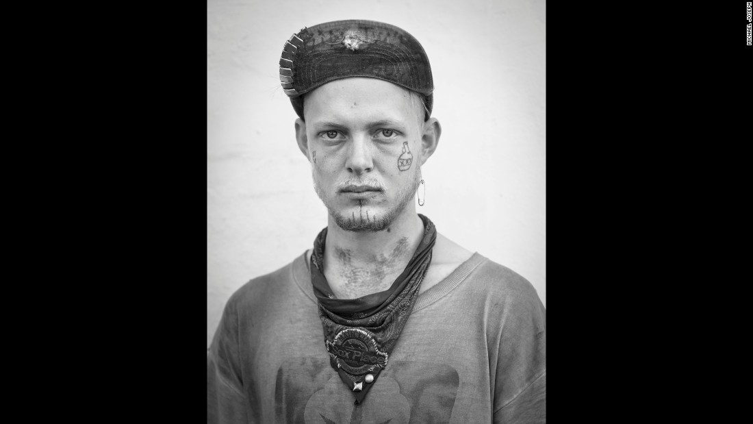 """I met and photographed this traveler in New Orleans,"" Joseph said. ""Travelers often have face tattoos. Some are common, such as the symbol for 'squatter's rights,' while others are personal. The jug with the XXX is a moonshine jug, and the triple X means that the shine has been run through the still three times so it's almost pure alcohol."""