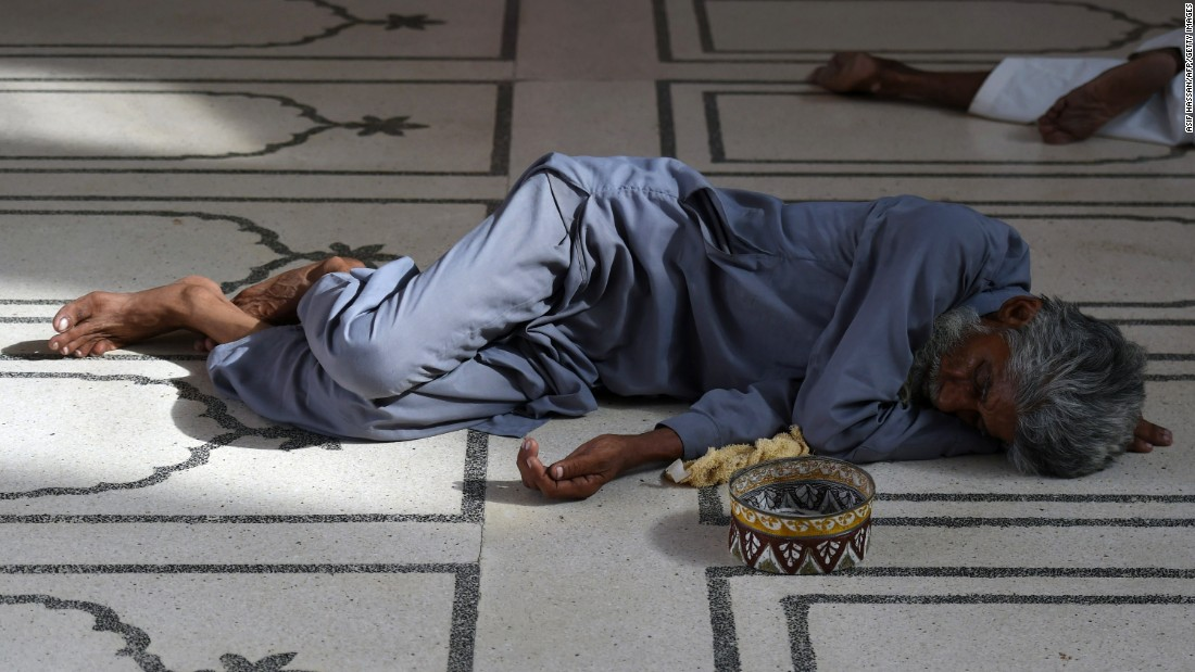 A Pakistani man rests at a mosque during the heat wave in Karachi on June 22.
