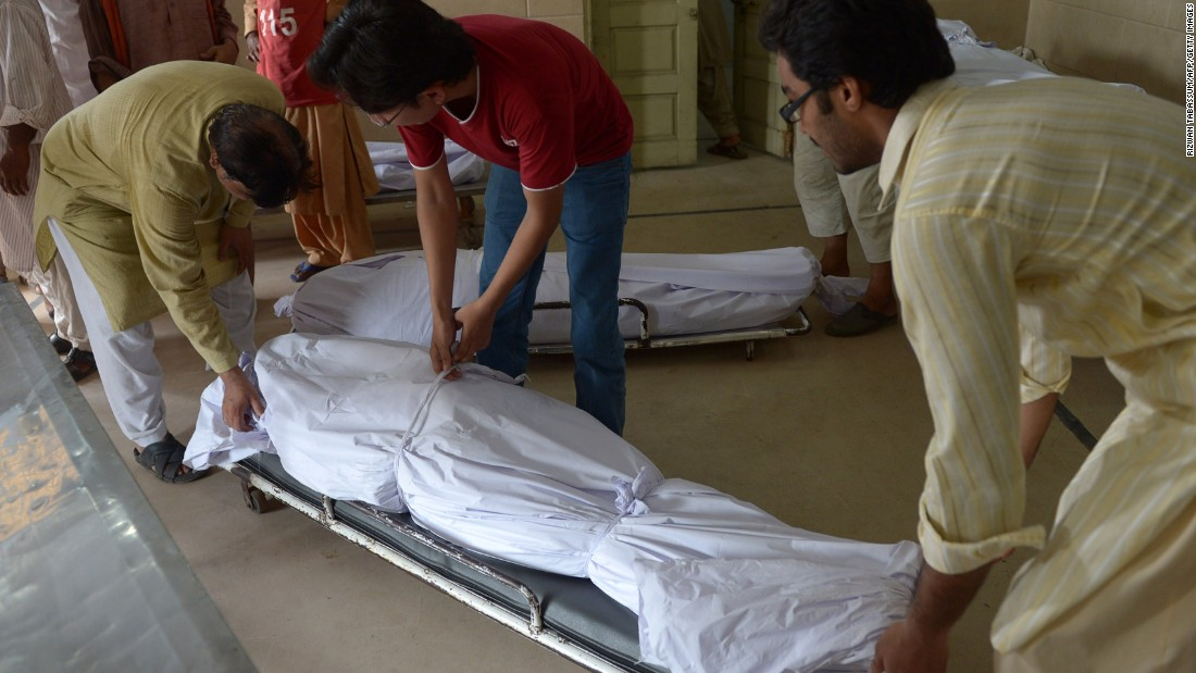 Pakistani volunteers and relatives prepare to shift the bodies of heat wave victims into the cold storage of the Edhi morgue in Karachi on June 22.