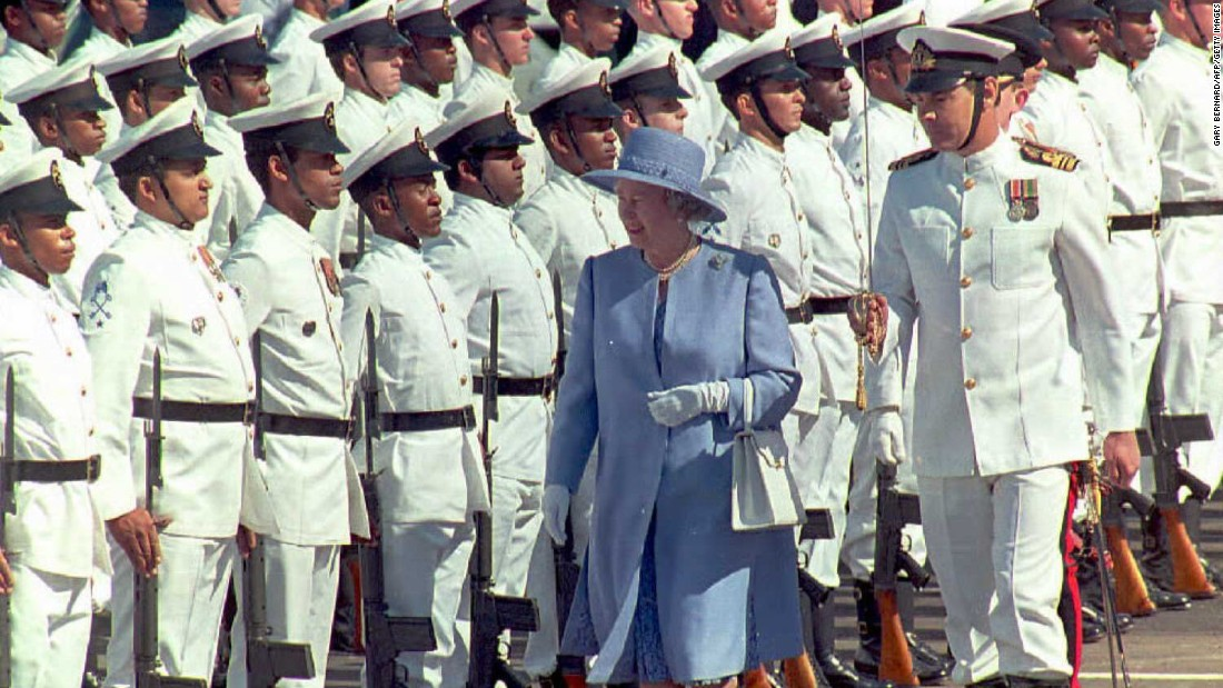 On her first state visit to South Africa, the Queen inspects the guards of honor at Cape Town's waterfront in March 1995.