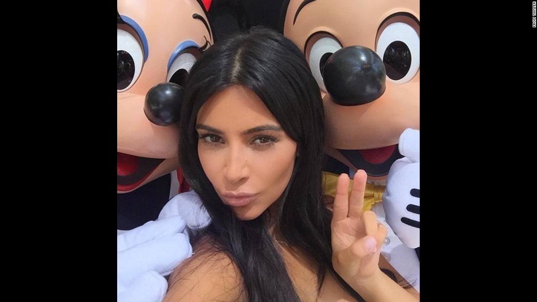 "Television personality Kim Kardashian <a href=""https://twitter.com/KimKardashian/status/611191267259609089"" target=""_blank"">tweeted this photo</a> of her with Mickey and Minnie Mouse on Wednesday, June 17."