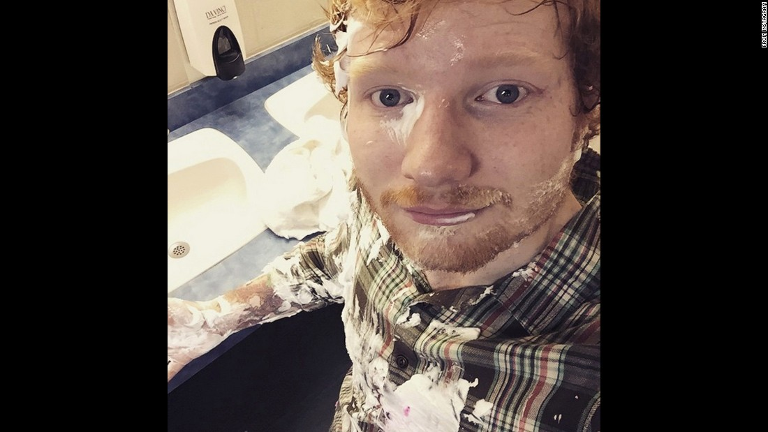 "Singer Ed Sheeran tries to clean pie off himself on Wednesday, June 17. ""It was Lindsay's birthday so we pied her, she pied me back,"" <a href=""https://instagram.com/p/4BD60jEpNU/?taken-by=teddysphotos"" target=""_blank"">he wrote on Instagram.</a>"