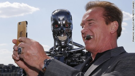 "US actor and former governor of California Arnold Schwarzenegger takes a selfie photo with the Terminator animatronics robot during a photo call for the film ""Terminator Genisys"" on June 19."
