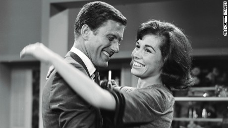 Dick Van Dyke as Rob Petrie and Mary Tyler Moore as Laura Petrie on the set.