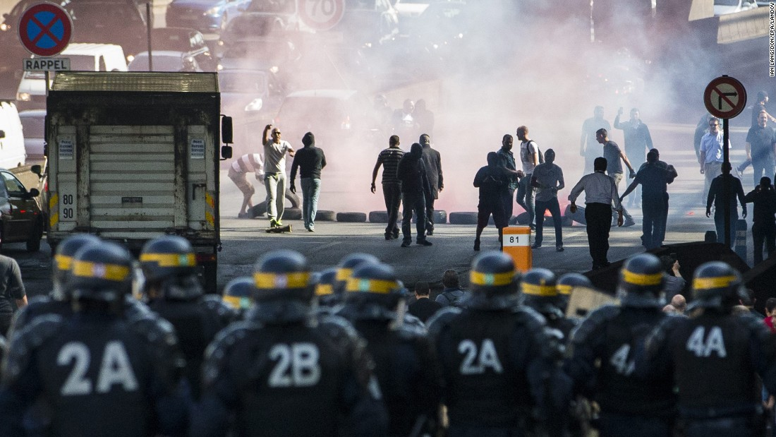 "French taxi drivers clash with riot police while disrupting Paris rush-hour during a<a href=""http://www.cnn.com/2015/06/25/europe/france-paris-uberpop-protests/""> protest against online ride service UberPOP</a> on Thursday, June 25. The cabbies say Uber threatens their jobs by taking customers away from licensed cab companies. The French goverment ruled the UberPOP app illegal last year, but the company hasn't exhausted all legal recourse."